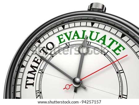 time to evaluate concept clock closeup isolated on white background with red and black words
