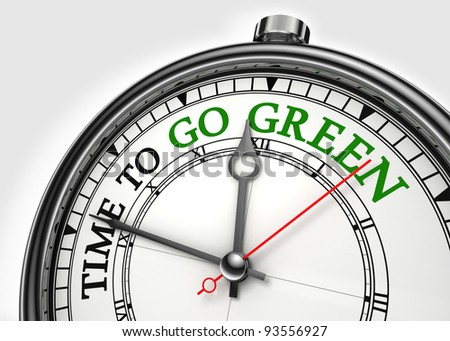 time to go green concept clock closeup on white background with red and black words