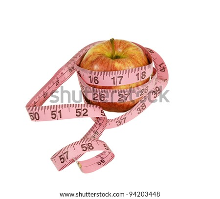 time to go on a diet!  apple with measuring tape on a white background