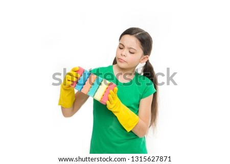 Time to grab a new one. Adorable kitchen maid. Small housekeeper holding dish sponges in rubber gloves. Little housemaid ready for household help. Household duties. Cleaning and washing up. #1315627871