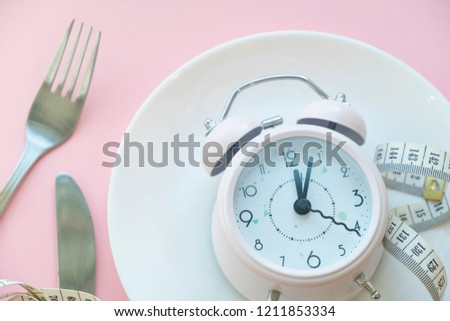 Time to lose weight , eating control or time to diet concept , alarm clock with healthy tool concept decoration on pink background #1211853334