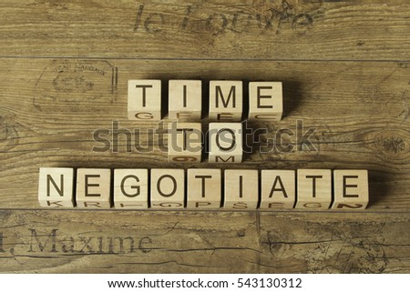 time to negotiate text on cubes on wooden background
