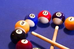 time to play pool (clock dial made of billiard balls and que-sticks )