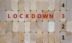 Time to 3rd lockdown. Wooden blocks form the words 'lockdown 3'. Numbers 1, 2, 4. Beautiful wooden background. Covid-19 pandemic and medical concept.