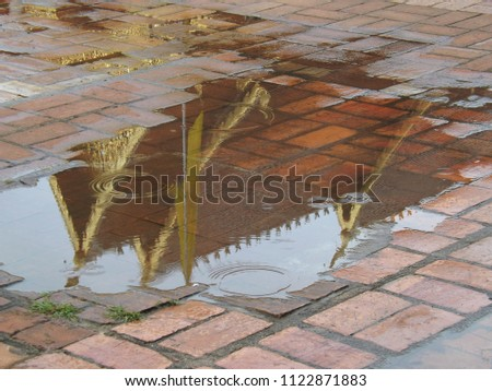 Time to reflect, time to visit Thailand. A temple in Chang Mai, Thailand. The temples roof reflected in a puddle. #1122871883