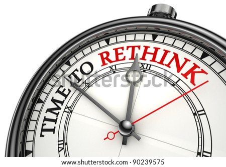 time to rethink concept clock closeup on white background with red and black words
