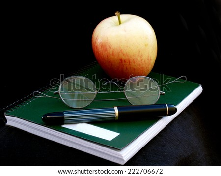 time to study: notebook, glasses, fountain pen and apple