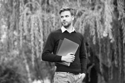 time to study. school teacher. man hold notebook. handsome guy walk with workbooks in park. modern life education. student get information from book. handsome unshaven student going to study outdoor