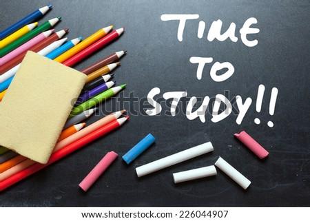 Time to study. School tools around. Blackboard background.