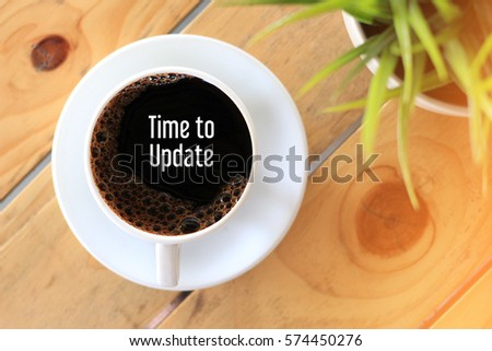 Time to update - business concept words on coffee cup