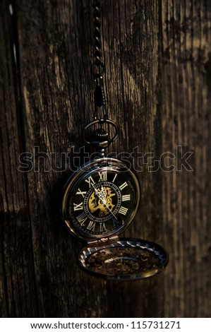 Time - Vintage Pocket Watch on Weathered Wood Background