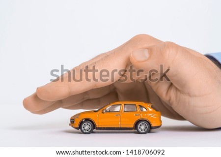 Time-worn car.Car (automobile) insurance and collision damage waiver concepts. Businessman with protective gesture Сток-фото ©