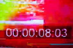 Timecode (time code) on the abstract glitch background. Timer. Glitch art. Digital errors on the screen. Digital artifacts.