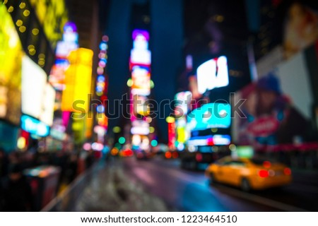 Times Square abstract defocus background night view of bright lights and traffic in wet winter street scene in New York City #1223464510