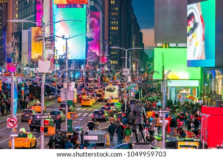 Times Square with neon art and commerce, an iconic street of Manhattan in New York City , United States
