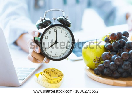 Times to Healthcare or Diet Food advisor show clock for timing care your health with healthy food and concept. Stock photo ©