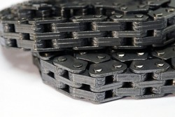Timing chain of an engine of a modern car. Macro photography. Individual links of the chain are in focus, the background is blurred.