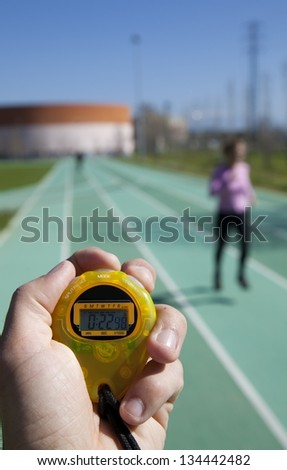 Timing times on a track a girl athlete