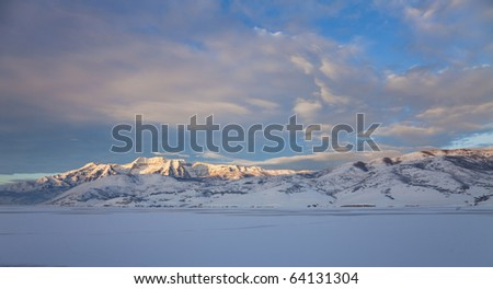 Timpanogos mountain in winter with deer creek reservoir in the foreground