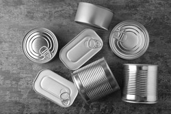 Tin cans on grey background