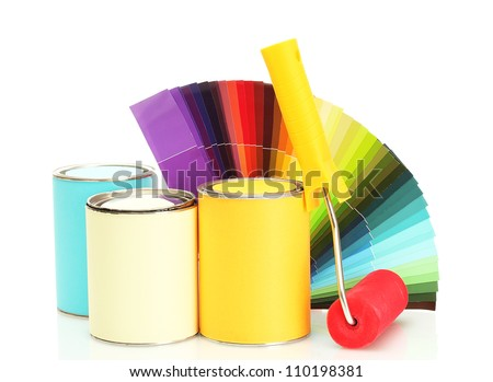 tin cans with paint, roller, brushes and bright palette of colors isolated on white