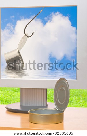 Tin facing and monitor on the desk - stock photo