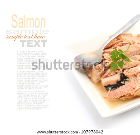 Tin Food Pink Salmon with spoon isolated on white background