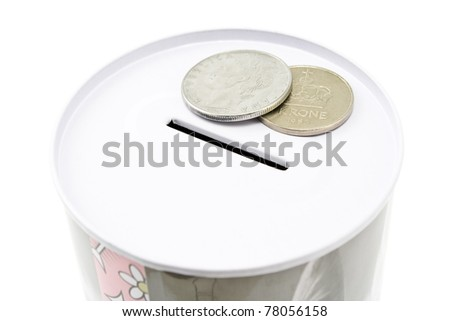 Tin money box with coins isolated on white