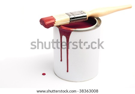Tin of red paint and paint brush