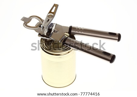 Tin opener opening a can of food isolated on white