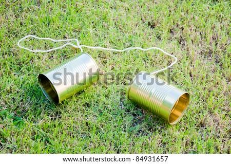 tin phone on grass field