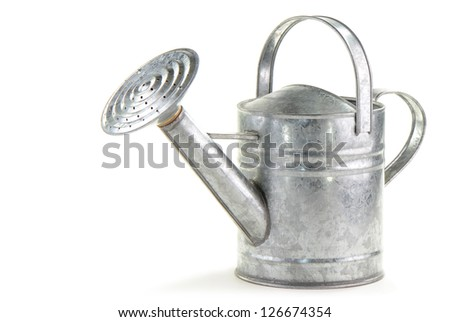Tin watering can on white background with room for text