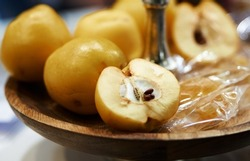 Tincture of quince and fruit on a wooden table. Selective focus. High quality photo