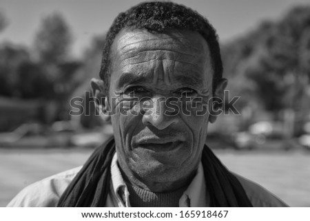TINHIR, MOROCCO - OCTOBER 20: Unidentified Mature berber man with traditional clothes, portrait, on October 20th, 2011 in Tinhir, Morocco