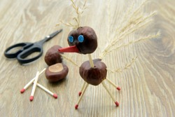 tinker creative chestnut bird figures in autumn. could be a stork or ostriches