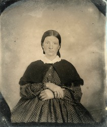 Tintype of woman in Civil War era. Mid 1800's. Looks pregnant. Lots of grunge and wear intact. With release.
