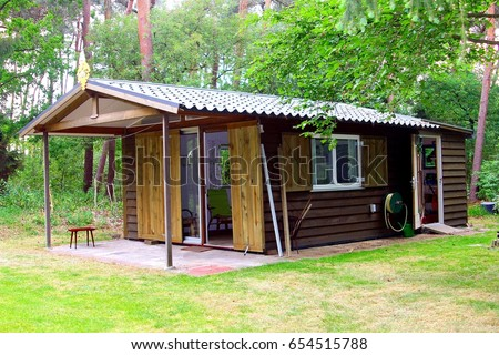 Tiny cabin house with kitchen, bedroom and bathroom in Dutch nature forest landscape, Netherlands