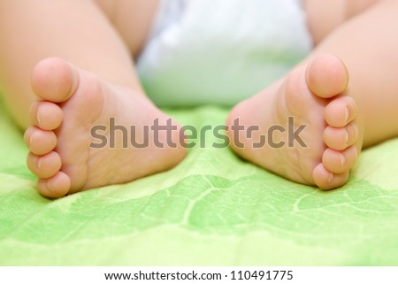 Tiny delicate pink newborn baby feet Can be used as the concept of parental care