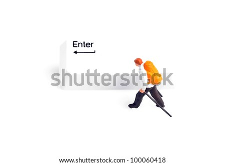 Tiny figure of hiker walking next to enter key