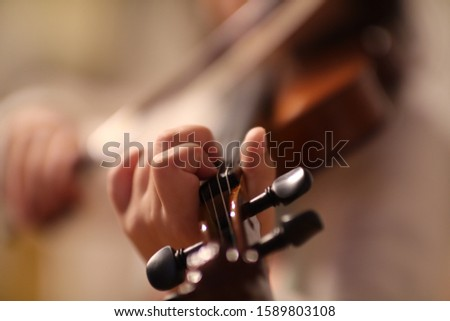 Tiny fingers on rough Violin strings