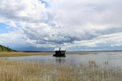 Tiny floating house on the lake