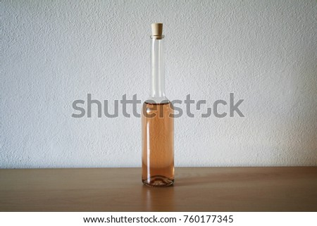 Stock Photo Tiny glass bottles full of colored liquid. With copy space