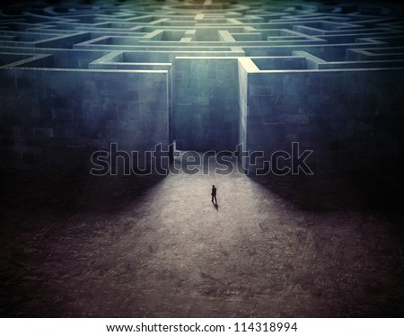Tiny man entering a mysterious maze