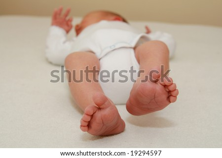 tiny newborn baby feet - 9 days old baby