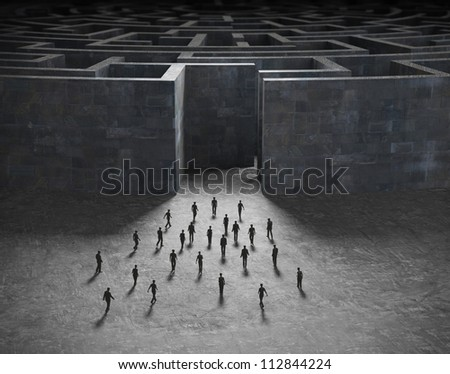 Tiny people entering a mysterious maze - stock photo