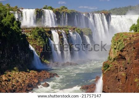 Tiny people on catwalks at the Iguazu Falls - The Devil's Throat