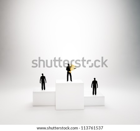Tiny people standing on a podium