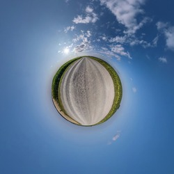 tiny planet in blue sky with beautiful clouds. Transformation of spherical panorama 360 degrees. Spherical abstract aerial view. Curvature of space.