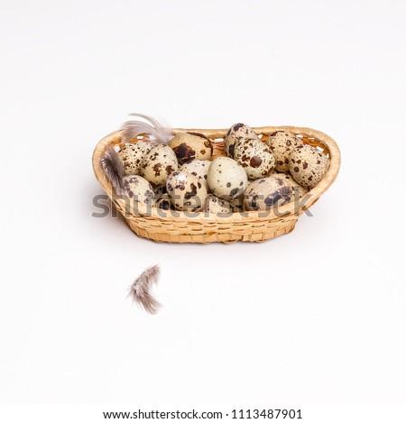 tiny quail eggs on a rustic...