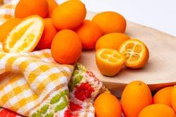 Tiny tropical Kumquat fruits isolated on a white background.